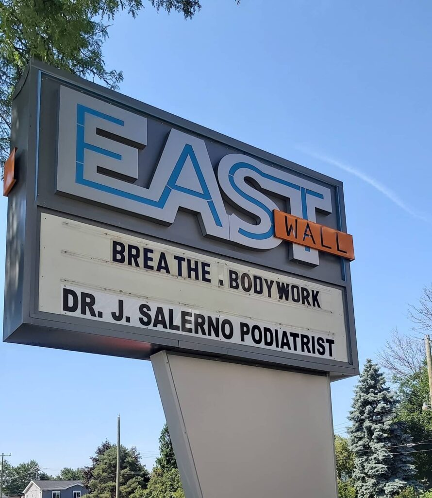 East Wall Collective Sign - Breathe Body Work and Beautification